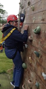 Photo of Tim on climbing wall